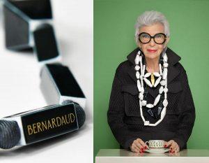 Iris Apfel porte un plastron et plusieurs sautoirs Be Bold Over qu'elle a dessinés pour Bernardaud ils sont formés par des disques noirs et ors.